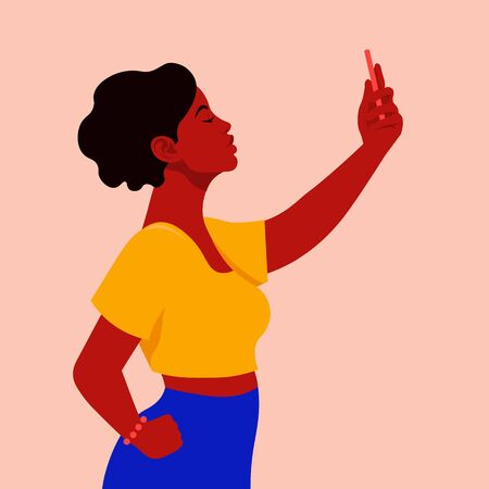 A beautiful African woman takes a selfie and holds her smartphone in her hand. A blogger is photographed for a social network. Vector flat illustration