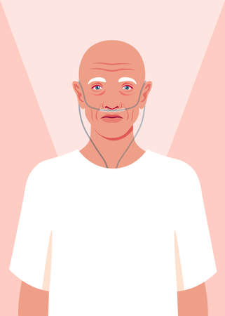 Bald senior man is standing in the hospital. Old cancer patient with a nasal breathing tube feeling lonely at hospice. Health care for the elderly people. Coronavirus and respiratory therapy.