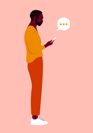 An African man is standing in profile and holding a smartphone. Figure of person in a full-length. Vector flat illustration  イラスト・ベクター素材