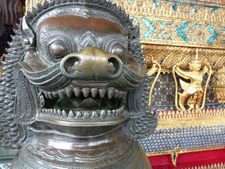 A picture of a statue head, in front of a temple, Bangkok photo
