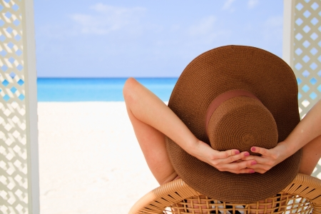 Girl in hat on the beach photo