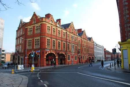 A crossroads in Dublin with typical building