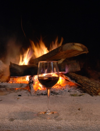 Logs burning in a fireplace - Liguria, Italy photo