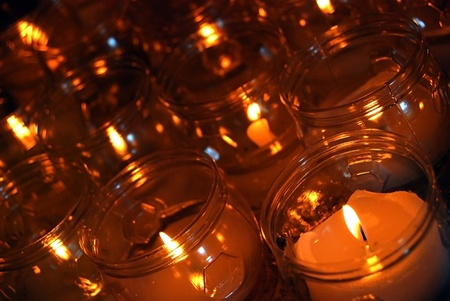 candleholders: Several candles light in a church Stock Photo
