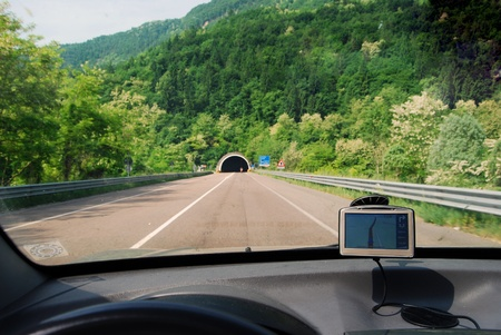 GPS - Global position solution - Satellite navigation system in use in a car on a road. photo