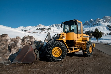 Snow removing with big bulldozer (Dolomites, Italy)