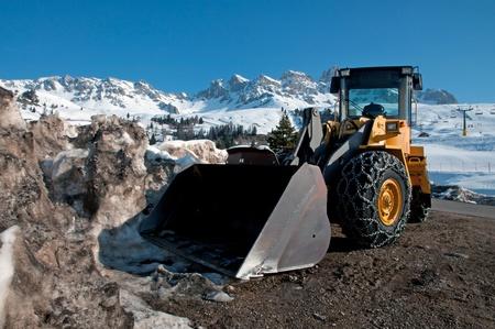 Snow removing with big bulldozer (Dolomites, Italy) photo