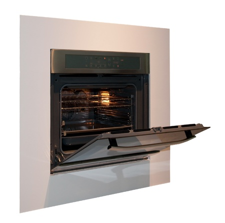 Built-in oven open, isolated on white background Standard-Bild