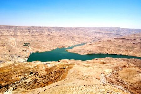 kilometres: Wadi Al-Mujib Dam. Located 100 kilometres south of Amman, between the governorates of Madaba and Karak, the Mujib Dam is designed to store rainwater for domestic, industrial and agricultural purposes.