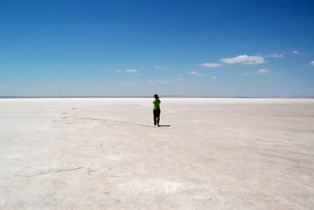 evaporate: Woman at Salt lake in Konya, Turkey