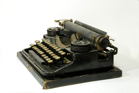 A typewriter is a mechanical or electromechanical device with a set of keys that, when pressed, cause characters to be printed on a medium, usually paper. For much of the 20th century, typewriters were indispensable tools in business offices and for man Stock Photo