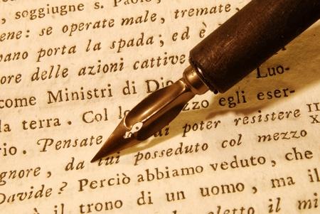Nib (pen) over an very old latin book photo