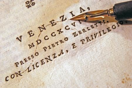 Nib (pen) over an old book photo