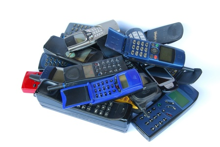 Old cell phones on white background photo