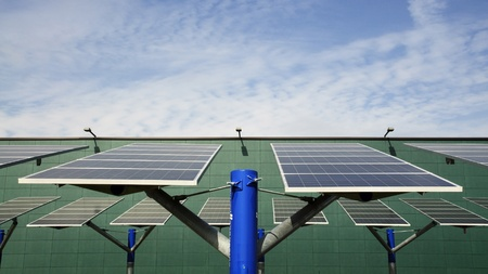 Renewable energy: solar panels in a parking lot of a highway Italian. A solar panel (photovoltaic module or photovoltaic panel) is a packaged interconnected assembly of solar cells, also known as photovoltaic cells. photo