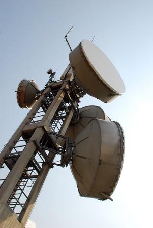 Communication cell tower for wireless technology: Gsm, Hsdpa, Umts, Gprs, Edge, Hsupa. photo