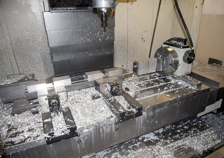 Drilling and milling CNC in workshop photo