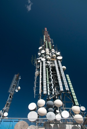 Big television and radio tower with several parabolic antenna on high quote (mountain) - Roncola (Italy) photo