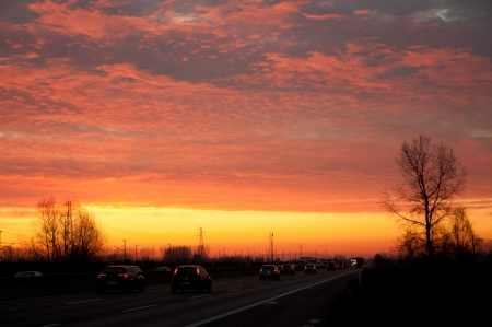 Traffic on the highway at dawn