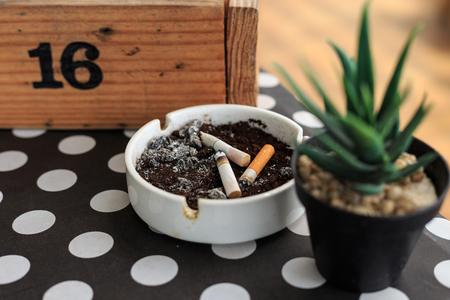 ashtray: Cigarette stub on ashtray