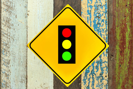 the traffic lights: Traffic lights sign on wood wall Stock Photo