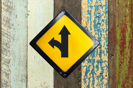 turn left sign: left turn split sign on wood wall Stock Photo
