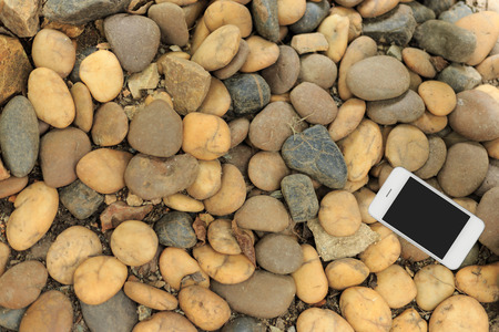 computer devices: Smartphone on stone floor