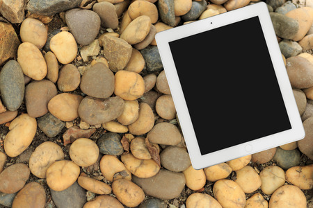 computer devices: Tablet on stone floor