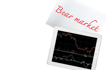 bear market: Paper with bear market text and tablet with graph is isolated on transparent