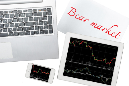 bear market: Smartphone, computer, paper with bear market text and tablet with graph is isolated on transparent Stock Photo