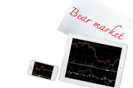bear market: Smartphone, paper with bear market text and tablet with graph is isolated on transparent