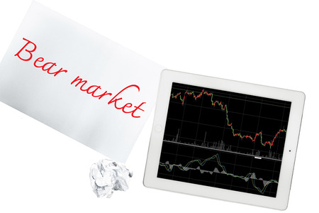 bear market: Tablet with graph and paper with bear market is isolated on transparent