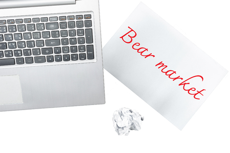 bear market: Computer and paper with bear market is isolated on transparent