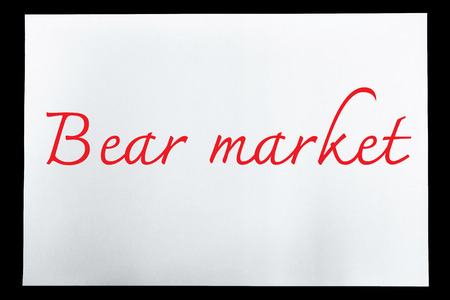 bear market: Paper with text bear market is isolated on black background