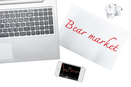 bear market: Smartphone, computer and paper with bear market is isolated on transparent Stock Photo