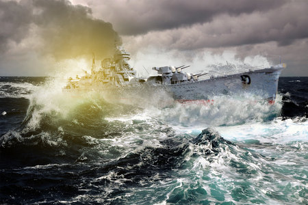 Warship sailing in a stormy sea Imagens