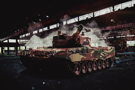 unstoppable: Modern Leopard tank in an abandoned hangar