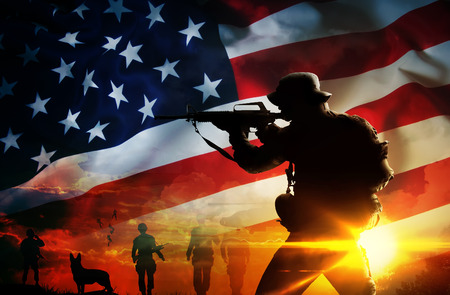 america soldiers: Silhouette of soldier at sunset Stock Photo