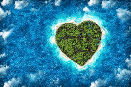The island in the shape of a heart with a birds eye view. Holidays on a desert island Stock Photo