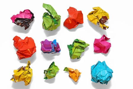 Crumpled color paper folded in a row. Crumpled paper isolated on white Stock Photo