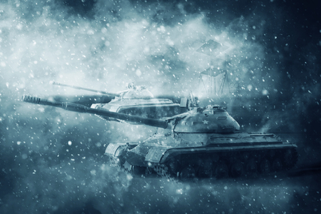 Two battle tanks moving in a snow storm on a mission
