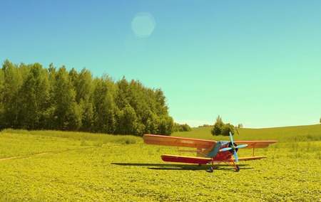 Watering aircraft without a pilot in the meadow
