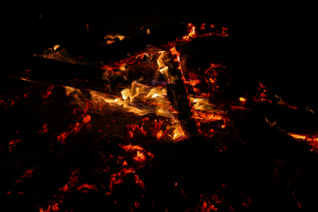 Smoldering coals on a black background