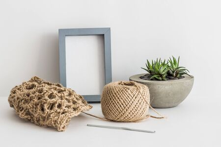Jute ball, cutter and photo frame on white