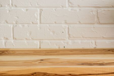 Wooden surface on a white brick background in vintage style