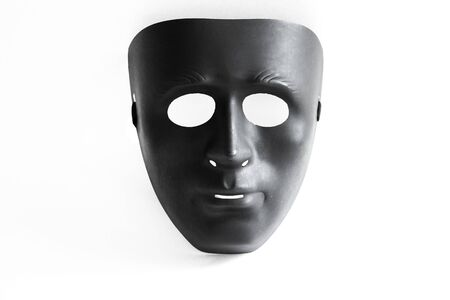 Black plastik mask on isolated white background