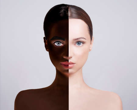 No to racism, the concept of sameness. The girl's face is divided into 2, Caucasian-looking girl and African-American in one person. We all people. Concept no to racism