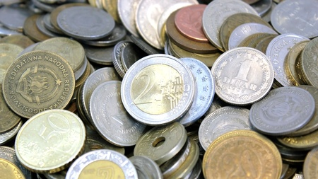 Macro of a group of coins from around the world with the euro in the foreground photo
