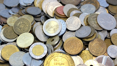 thaler: Macro of a group of coins from around the world with the euro in the foreground Stock Photo