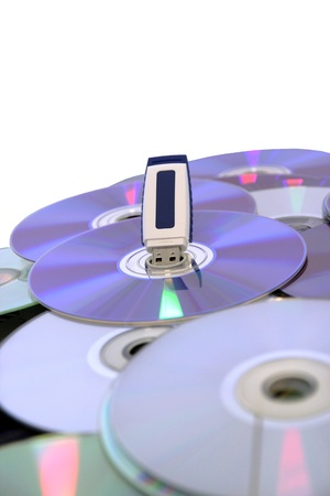 USB Pen Drive on CDs and DVDs, the innovation Stock Photo - 13128880